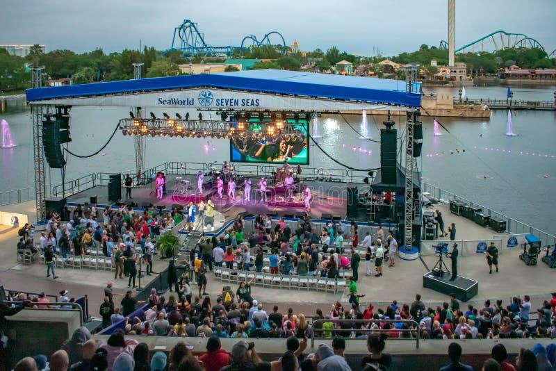 Alexander Delgado and the band by Gente de Zona singing urban music at Seaworld in International Drive area. Orlando, Florida. March 17, 2019. Alexander Delgado stock images