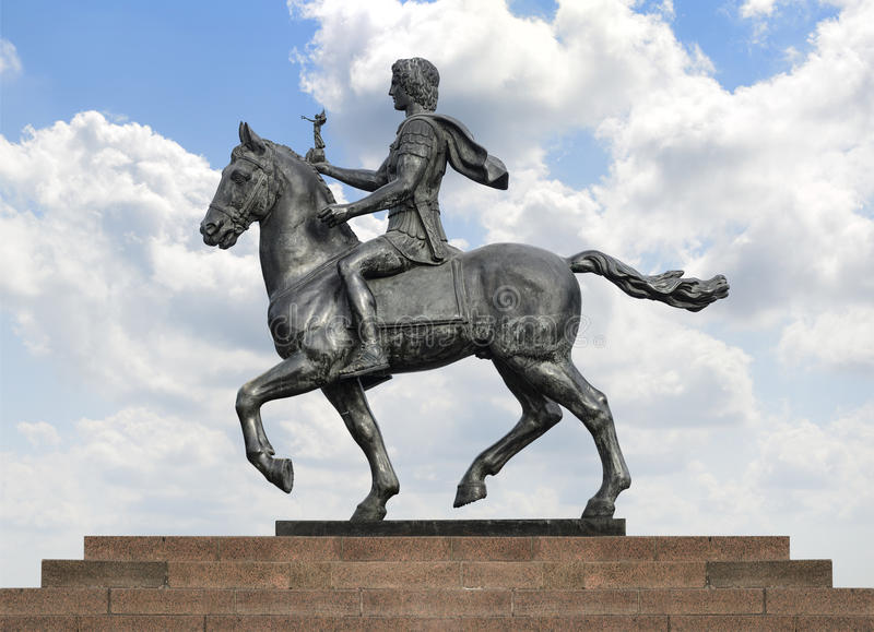 Alexander The Great on Horse over Blue Sky. Statue of Alexander The Great Riding on His Horse over Blue Sky royalty free stock photos