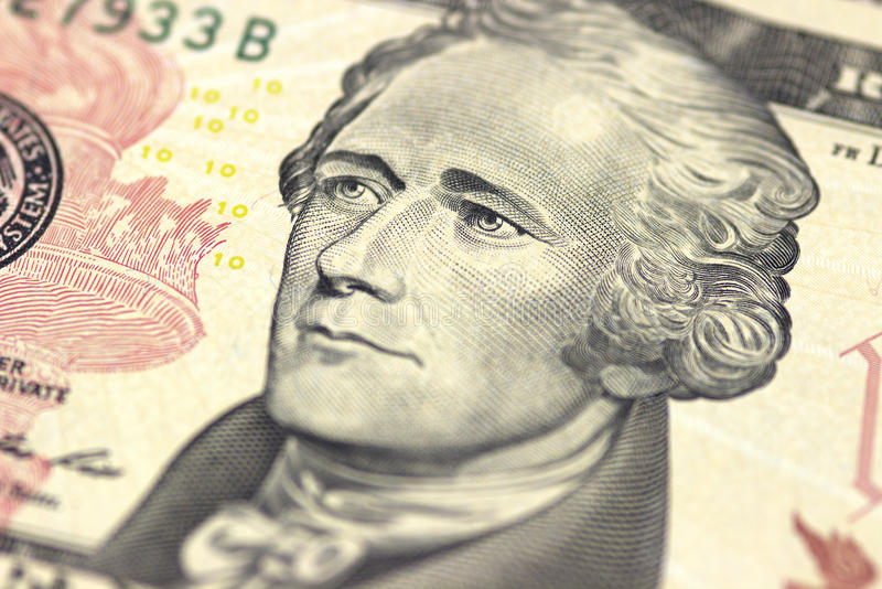 Alexander Hamilton face on US ten or 10 dollars bill macro, united states money closeup. stock photos