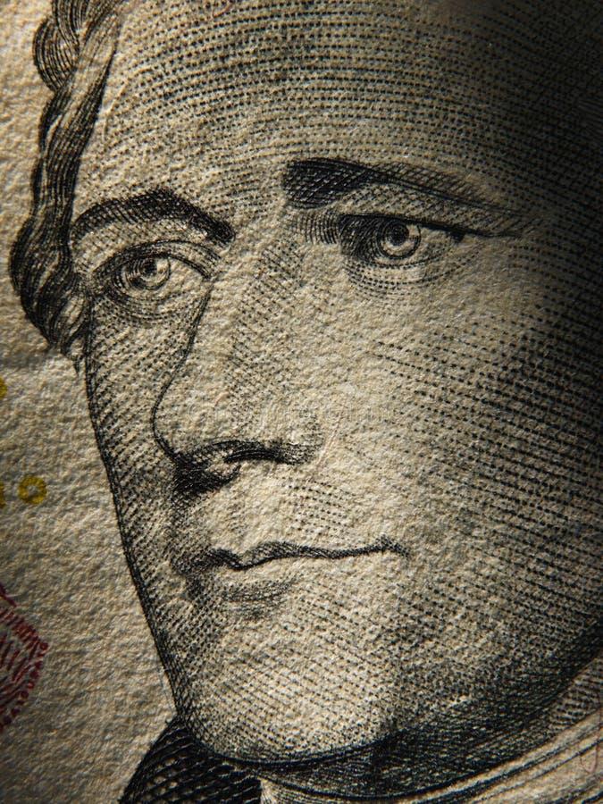 Alexander Hamiltons que el retrato se representa encendido pintó en los billetes de banco de $ 10 imagen de archivo