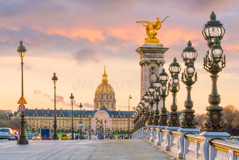 The Alexander III Bridge across Seine river in Paris. France at sunrise royalty free stock image