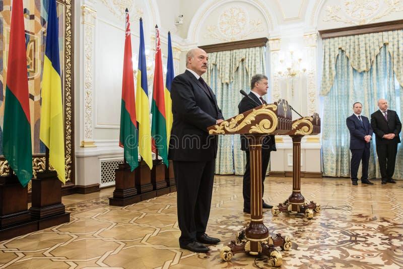 Alexander Lukashenko och Petro Poroshenko arkivbild