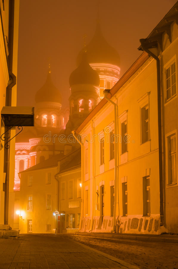 Alexander Nevsky Cathedral illuminated by night in heavy fog. Tallinn, Estonia royalty free stock image