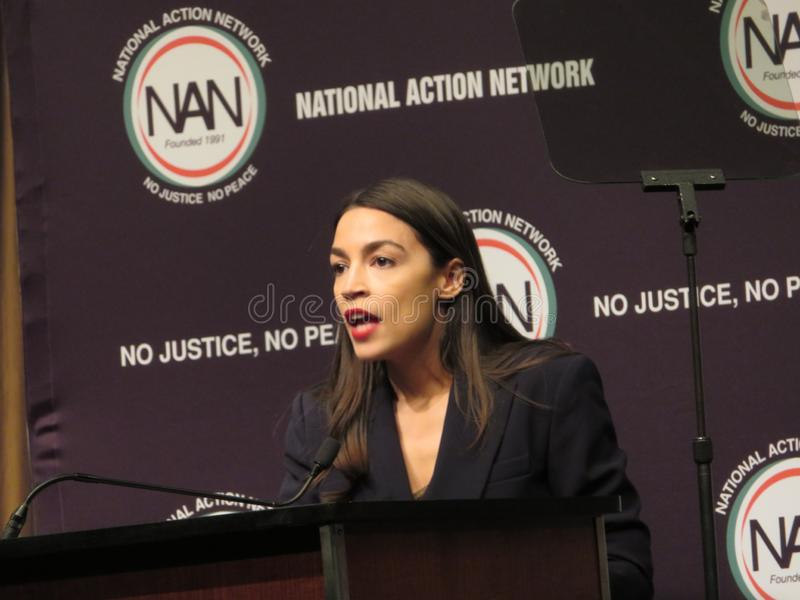 Alexandra Ocasio-Cortez en la conferencia nacional de la red de la acción imagen de archivo libre de regalías