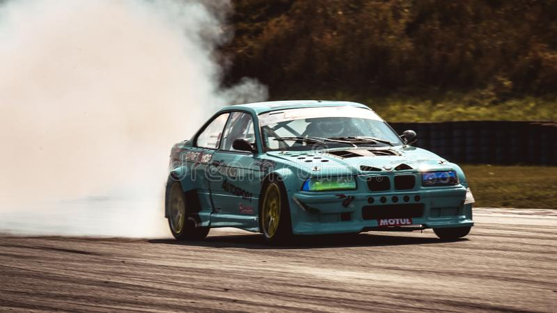 Alexandre Strano driving a BMW E36 M3 Turbo by Strano Autosport during a race car. Oschersleben, Germany, August 31, 2019: Alexandre Strano driving a BMW E36 M3 royalty free stock images