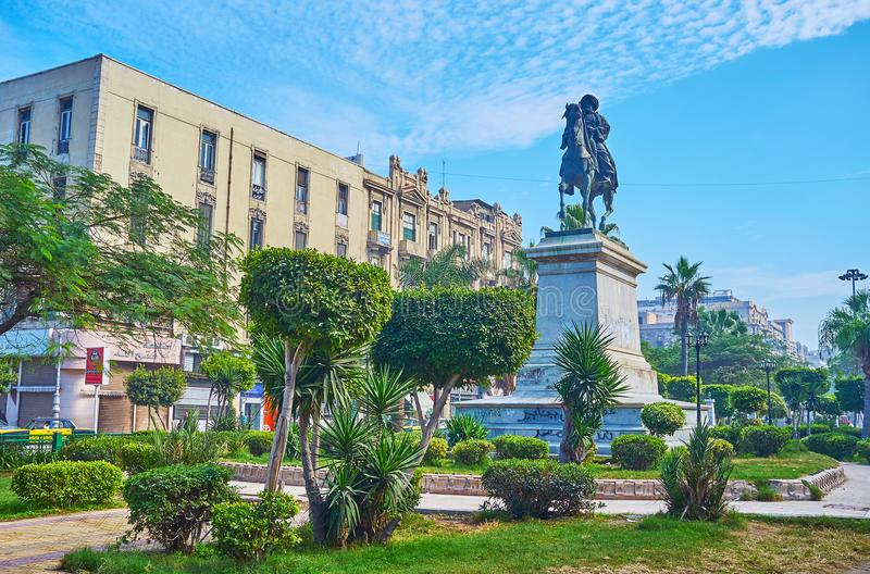 Garden in Tahrir square, Alexandria, Egypt. ALEXANDRIA, EGYPT - DECEMBER 17, 2017: The equestrian statue of Muhammad Ali Pasha among the trimmed bushes in garden stock photo