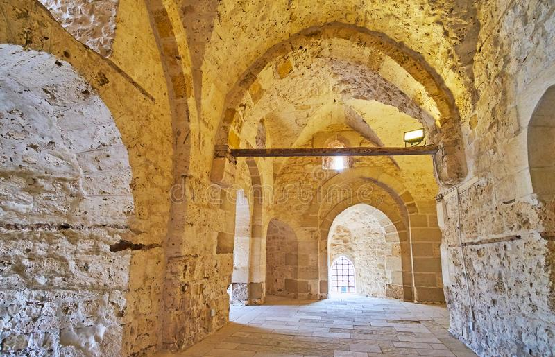 Discover castle of Qaitbay, Alexandria, Egypt. ALEXANDRIA, EGYPT - DECEMBER 17, 2017: The old stone hallway in Qaitbay Castle, the medieval defensive stronghold stock photo