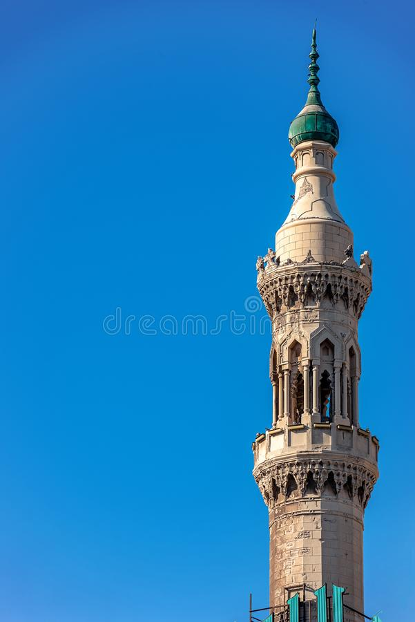 18/11/2018 Alexandria, Egypt, Minaret of the Abo El Abass mosque against a blue sky stock photography