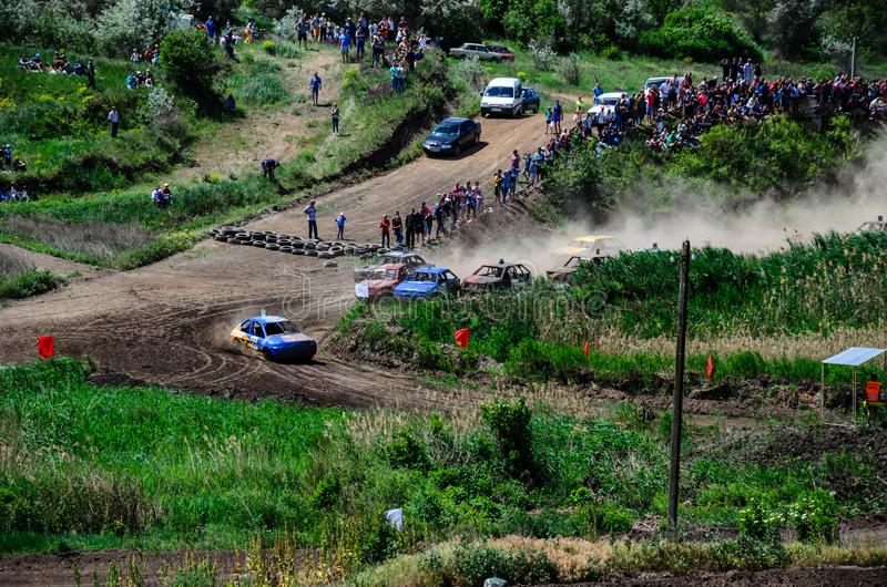 Alexandria, Ukraine - June 10, 2017: Race of the old wrecked cars. Rally on open air with dust stock images
