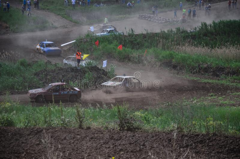 Alexandria, Ukraine - June 10, 2017: Race of the old wrecked cars. Rally on open air with dust stock image