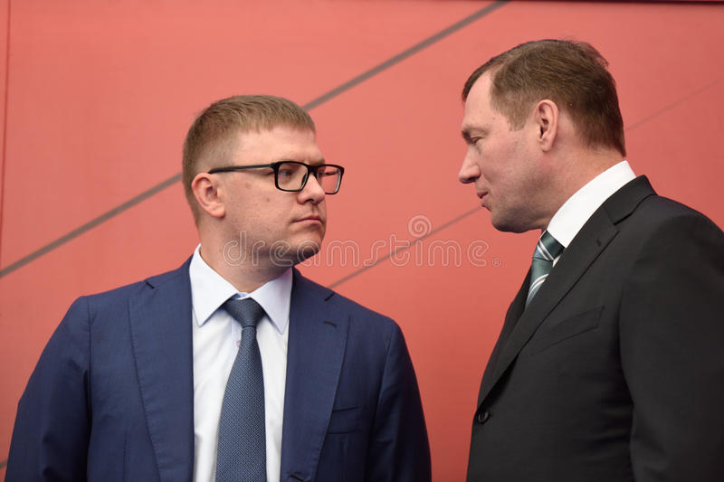Alexey Teksler and Oleg Budargin. St. Petersburg, Russia - June 20, 2015: Deputy Minister of enerty of Russia Alexey Teksler (left) and General director of JSC stock photography