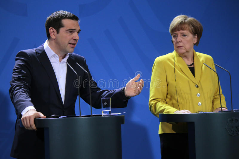 Alexis Tsipras, Angela Merkel. MARCH 23, 2015 - BERLIN: Greek Prime Minister Alexis Tsipras, German Chancellor Angela Merkel at a press conference after a stock image