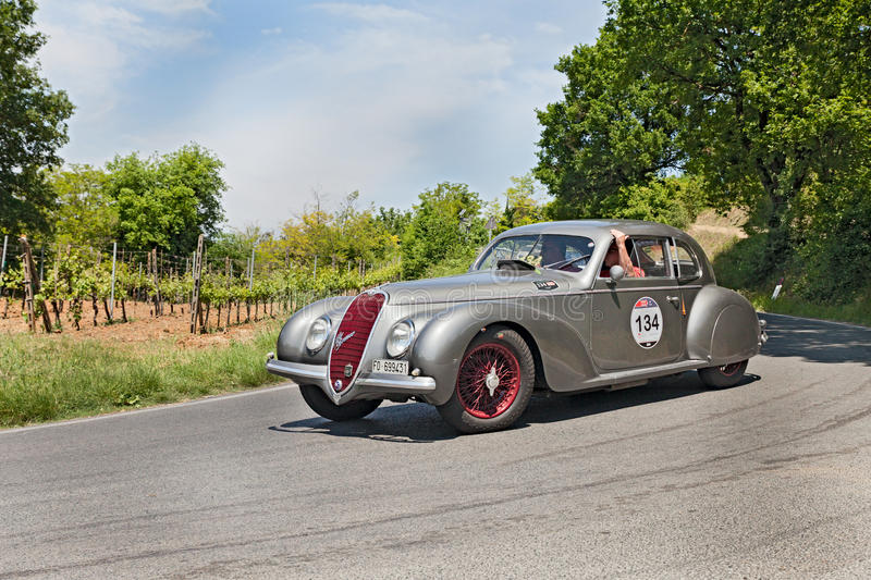 Alfa Romeo 6C 2500 SS (1939) runs in Mille Miglia 2014. COLLE DI VAL D'ELSA, SI, ITALY - MAY 17: unidentified crew on a vintage sport car Alfa Romeo 6C 2500 SS ( royalty free stock image
