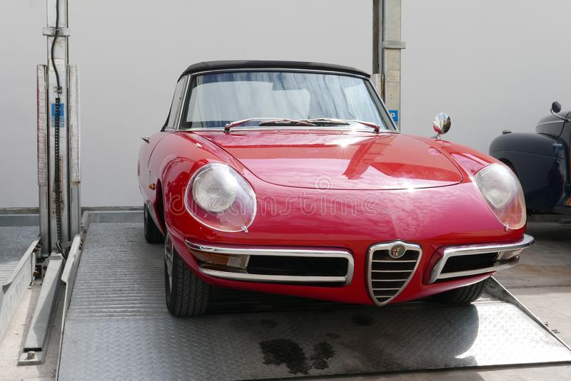 Alfa Romeo Spider Duetto two door roadster in Lima. Lima, Peru. May 6, 2018. Front view of a mint condition red and black color convertible Alfa Romeo Spider royalty free stock photography