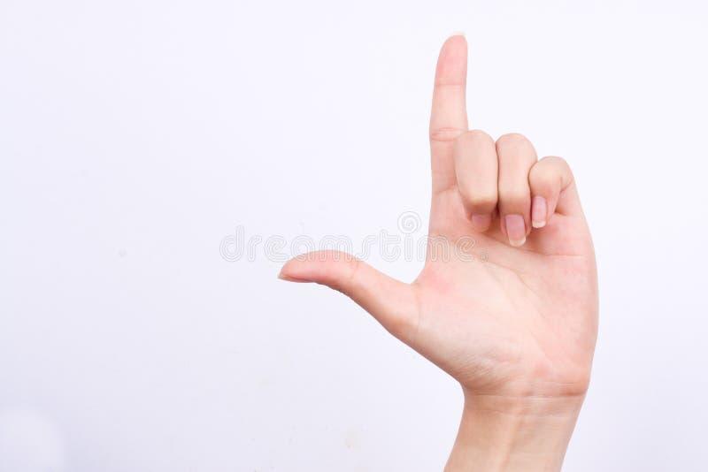 Alfa vera di concetto di simboli della mano del dito che ostacola il segno del perdente sui precedenti bianchi fotografia stock