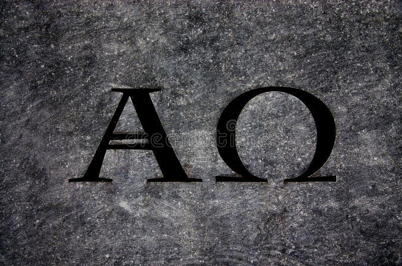 Alfa y Omega en piedra fotos de archivo