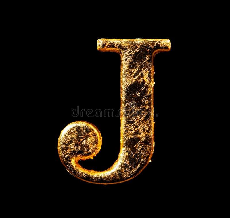 Alfabet en aantallen in bladgoud stock fotografie