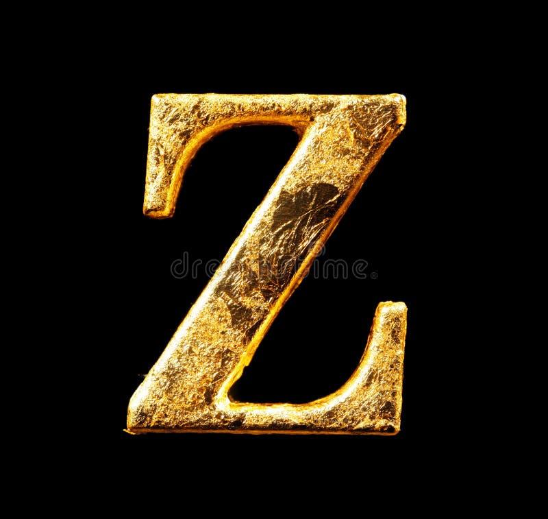 Alfabet en aantallen in bladgoud stock foto's