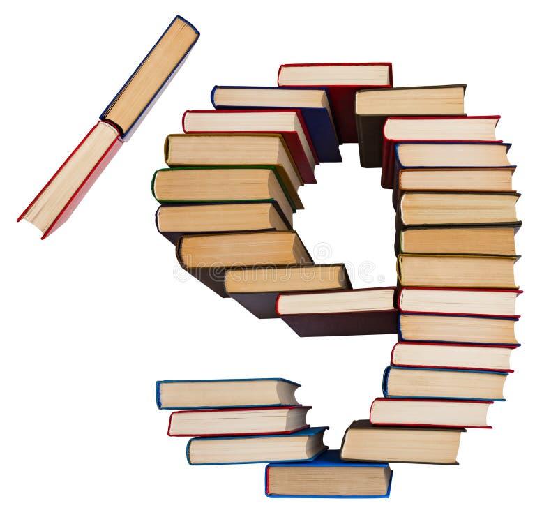 Alfabet som göras ut ur böcker, diagram 9 och snedstreck arkivfoton