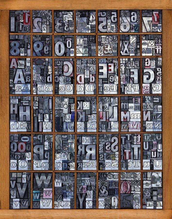 alfabetboktryck arkivfoto