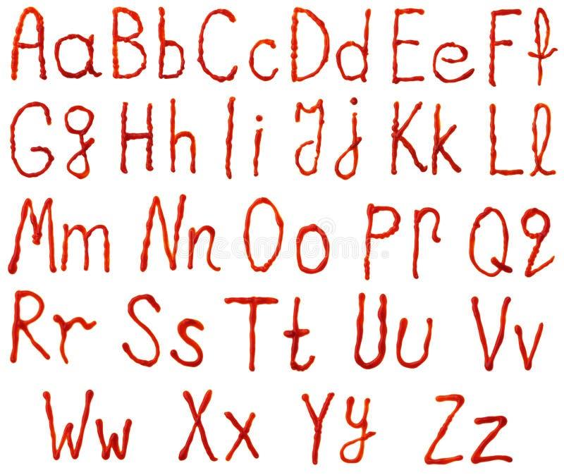 Alfabetbrieven van ketchup worden gemaakt die stock afbeeldingen