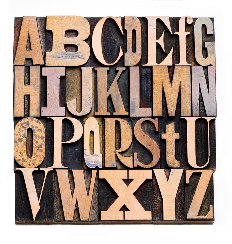 Alfabeto di legno dello scritto tipografico fotografia stock libera da diritti