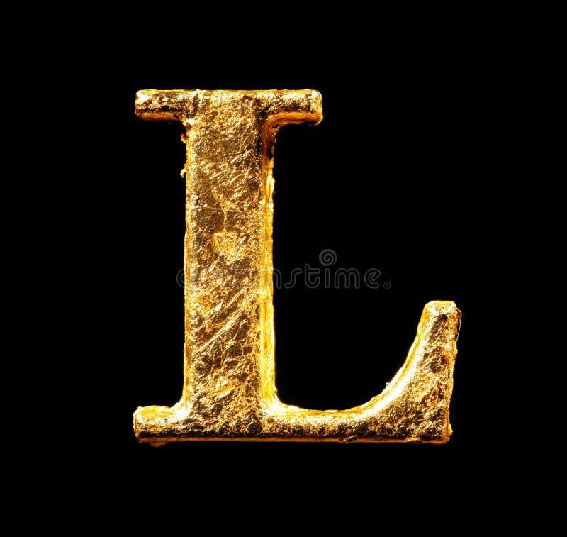 Alfabeto e números na folha de ouro fotografia de stock royalty free
