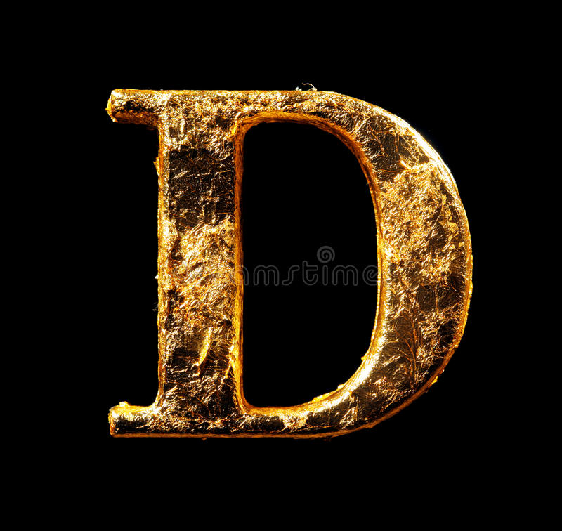Alfabeto e números na folha de ouro imagens de stock royalty free