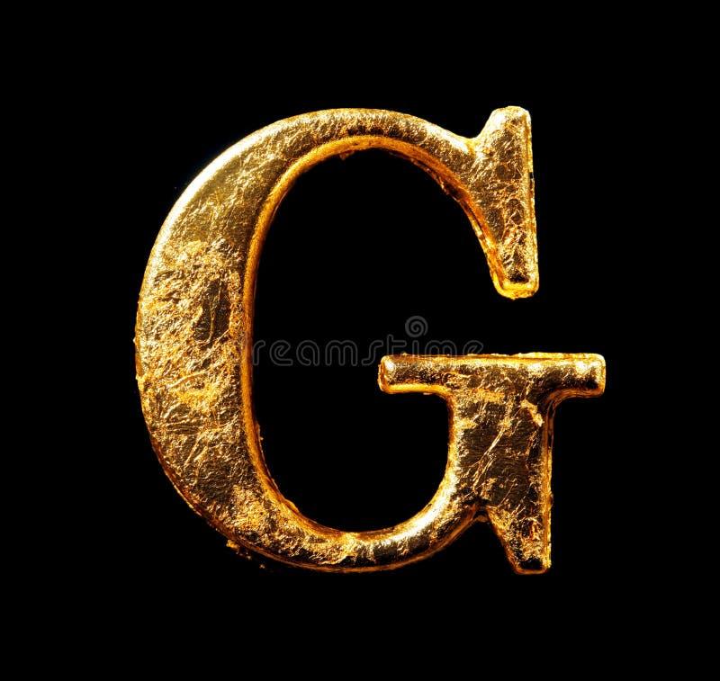 Alfabeto e números na folha de ouro imagens de stock