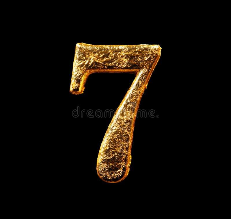 Alfabeto e numeri in foglia di oro fotografie stock