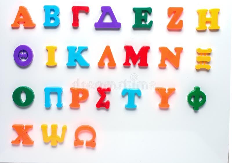 Alfabeto grego do brinquedo fotografia de stock