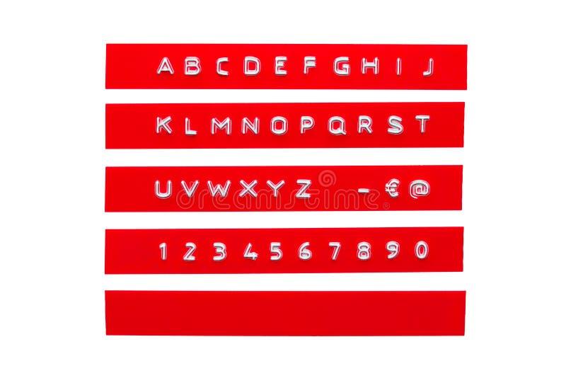 Alfabeto impresso su nastro di plastica rosso illustrazione di stock