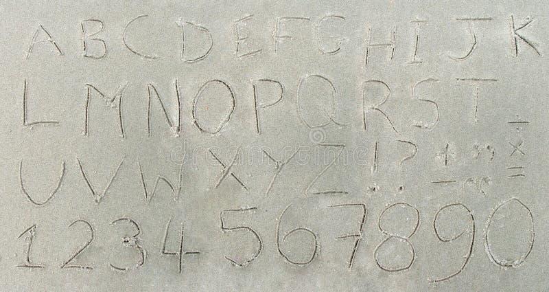 Alfabeto na areia fotografia de stock royalty free