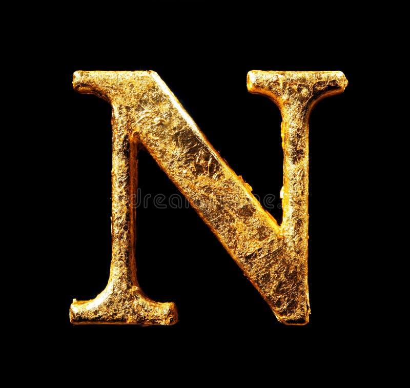 Alfabeto y números en hoja de oro fotografía de archivo