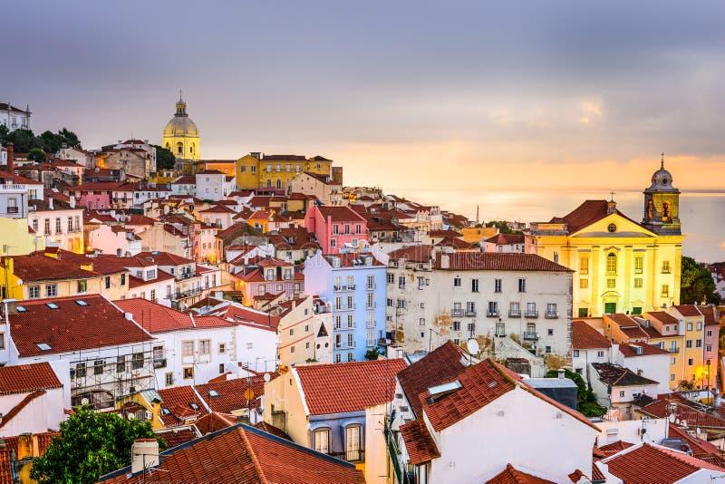 Alfama, Lisbon, Portugal Cityscape. Lisbon, Portugal cityscape at the Alfama district at dawn stock images