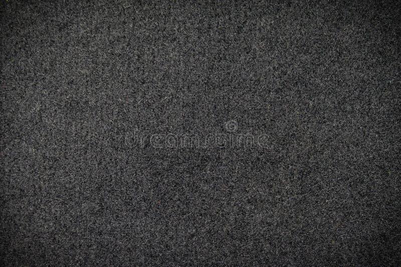 Alfombra negra o fondo negro de la textura de la tela de lana imágenes de archivo libres de regalías