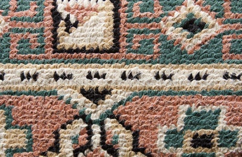 Alfombra persa y manta imagen de archivo