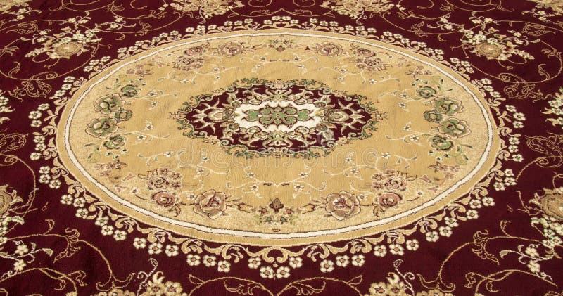 Alfombra persa y manta foto de archivo