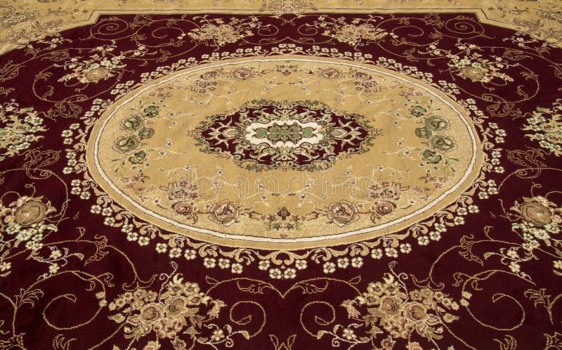 Alfombra persa y manta foto de archivo libre de regalías