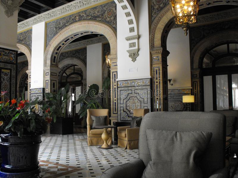Alfonso XIII connecting Lobby. Alfonso XIII Hotel main lobby antique furniture Marble tiled floor tiled walls Lantern royalty free stock image