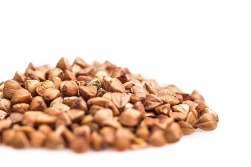 Alforfón del puñado, granos de cereal, comida sana del concepto fotos de archivo