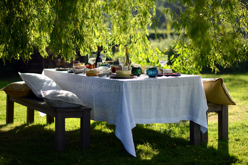 Alfresco dining. Table set for an evening meal outside stock photo