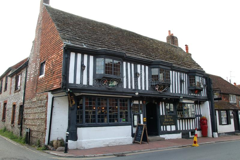 Alfriston The Star Inn Public house, East Sussex. Alfriston is a village and civil parish in the East Sussex district of Wealden, England. The village lies in stock photo