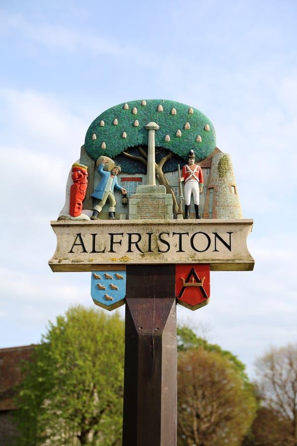 Alfriston Village sign, East Sussex. Wooden painted Alfriston village sign stock photo