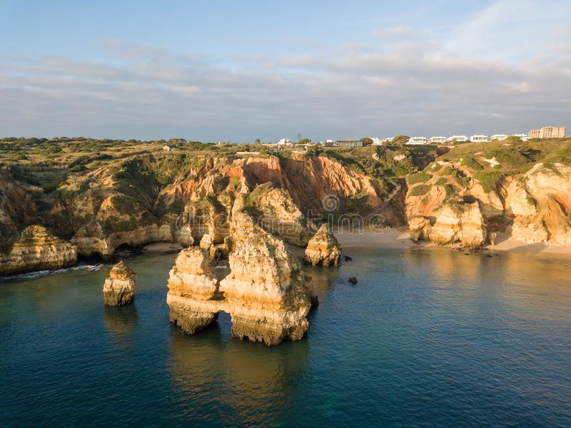 Algarve aerial drone panoramic view. Amazing landscape at sunrise. Beautiful beach near Lagos, Algarve region, Portugal.  Seascape stock image