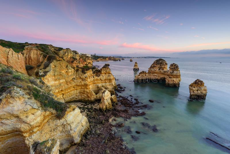 Algarve aerial drone panoramic view. Amazing landscape at sunrise. Beautiful beach near Lagos, Algarve region, Portugal.  Seascape. Amazing landscape at sunrise stock photography