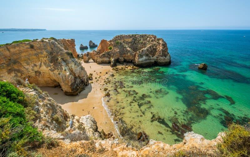 Scenic golden cliffs near Alvor, Portimao, Algarve stock images