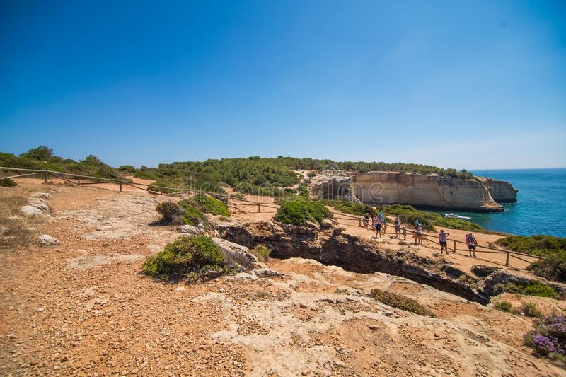 ALGARVE, PORTUGAL - July 2018: Beach cave of Benagil in Carvoeiro, a popular tourist attraction considered one of the most beautif royalty free stock image
