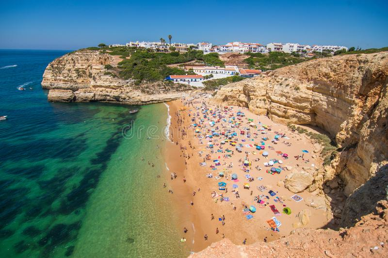 ALGARVE, PORTUGAL - July 2018: Beach cave of Benagil in Carvoeiro, a popular tourist attraction considered one of the most beautif royalty free stock photography