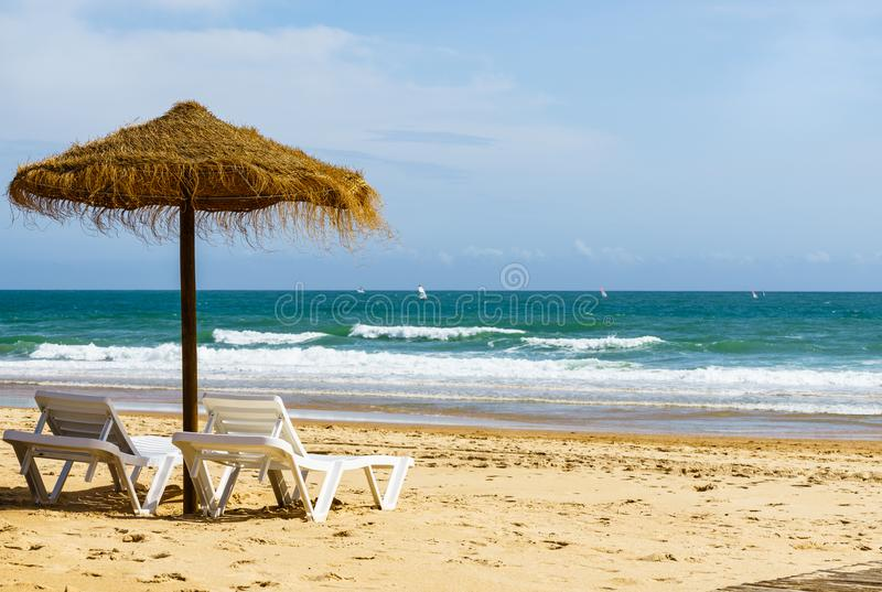 Algarve, Portugal, a stunning sea ocean landscape with sunbeds and umbrella. royalty free stock photo